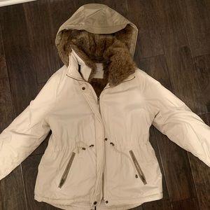 Barney's white winter coat